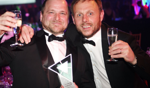 Paul Anderson and Rob Gray holding an award