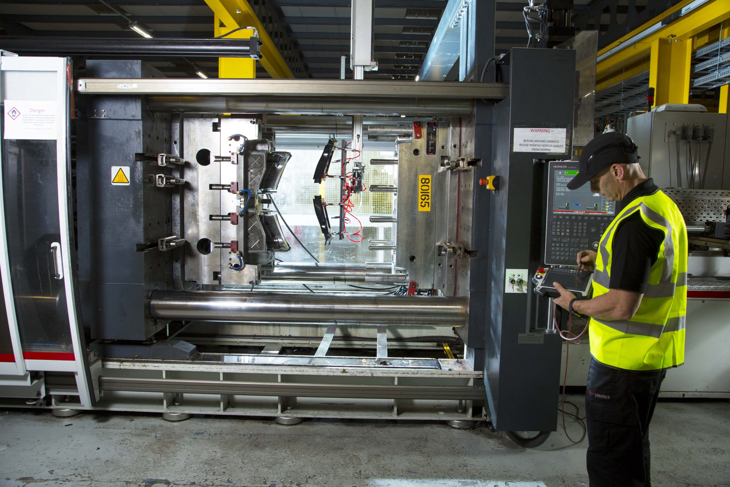 Colleague maintaining a moulding machine