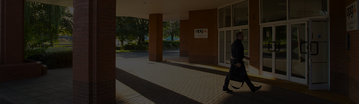 Man walking into OPG building